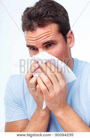 Sneezing man having cold. Isolated on white background.
