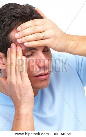 Young man having a headache. Stress. Isolated on white background.