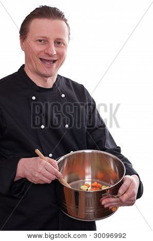 Smiling Cook Is Cooking Vegetables In A Pot