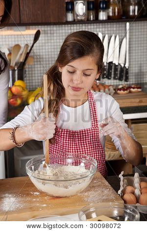 Young Girl In The Kitchen