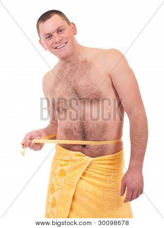Beautiful athletic man in yellow towel with measure