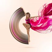 Graceful Ballet Dancer Or Classic Ballerina Dancing Isolated On Studio Background. Woman Dancing Wit poster