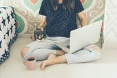 Girl Freelancer Blogger With Laptop And Doggy Sits On The Floor. poster