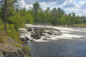 Rocky Cascade In The Heart Of The North Woods At Bald Rock Falls In The Falls Chain In Quetico Provi poster