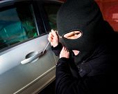stock photo of scumbag  - robber and the thief hijacks the car - JPG