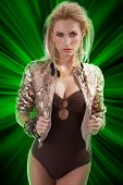 stock photo of youg  - blond beautiful youg woman with feather earrings with hair style and wearing a shining sequins jacket - JPG