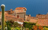 Scenic View Of The Mediterranean Coastline And Medieval Houses From The Top Of The Town Of Eze Villa poster
