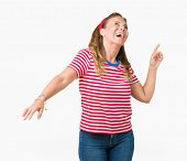 Beautiful middle age woman wearing casual stripes t-shirt over isolated background Dancing happy and poster