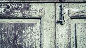 Vintage Old Lock On The Door. Lock On The Door Of An Old Farmhouse True Village Style. Close-up Focu poster