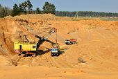 Quarry Excavator Loading Sand Or Into Dump Truck At Opencast. Excavation Of Mineral Resources, The W poster