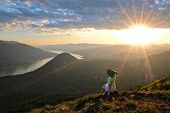 Woman Meditating And Relaxing On Mountain Top. Scenic View From Dog Mountain In Columbia River Gorge poster