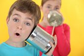 stock photo of toy phone  - Children communicating with tin cans - JPG