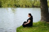 Body Positive, Yoga, Meditation, Tranquility, Relax. Overweight Woman Meditating Sitting Outdoors. H poster