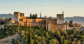 View Of Alhambra Palace In Granada, Spain With Sierra Nevada Mountains At The Background poster