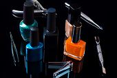 Manicure And Pedicure Tools On Black Background, Isolated. Equipment For Beauty Shop, Cosmetic Salon poster