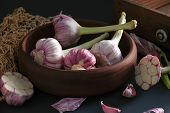 Fresh Garlic. Kind Of Garlic In A Clay Plate Sitting Against A Dark Background. Mill Food. Harvest F poster