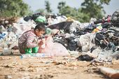 Poor Boy Collecting Garbage In His Sack To Earn His Livelihood, The Concept Of Poor Children And Pov poster