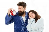 An Early Morning Hour. Sleepy Woman And Bearded Man Holding Alarm Clock Early In The Morning. Sexy G poster