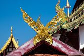 Kalae Roof Style In A Temple In Chingmai Province, It Is Thai Northern Traditional Decorative Or Lan poster