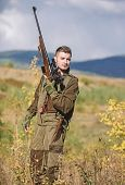 Man With Rifle Hunting Equipment Nature Background. What You Should Have While Hunting Nature Enviro poster