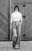 Fashionable Outfit Slim Tall Lady. Fashion And Style Concept. Woman Walk In Loose Pants. Woman Fashi poster