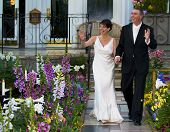 foto of wedding couple  - A wedding couple walk down the aisle - JPG