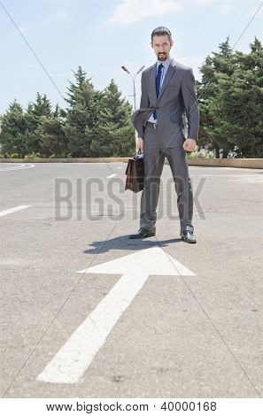 Businessman ready to start running