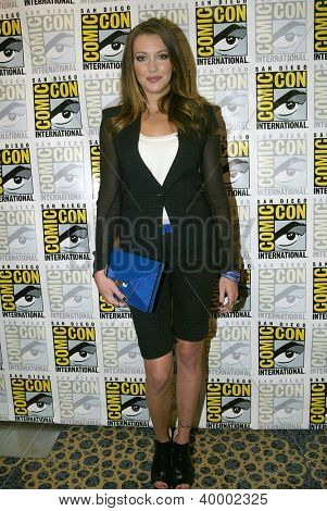 SAN DIEGO, CA - JULY 13: Katie Cassidy arrives at the 2012 Comic Con convention press room at the Bayfront Hilton Hotel on Friday, July 13, 2012 in San Diego, CA.