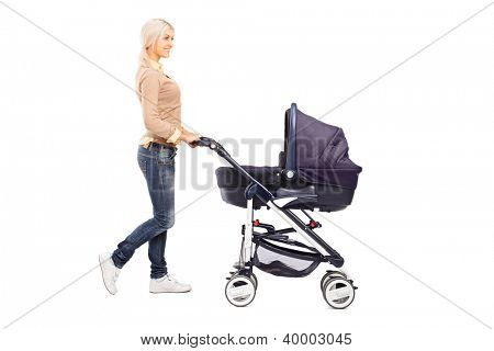 Full length portrait of a mother pushing a baby stroller isolated against white background