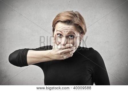 Woman covering his mouth