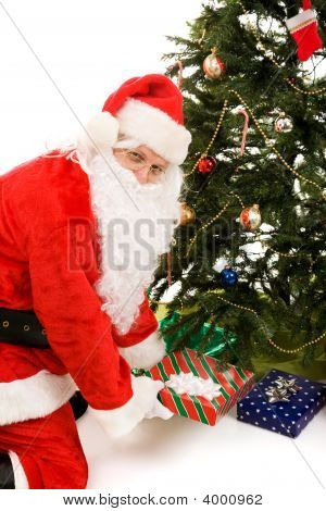 Santa Under Tree With Presents