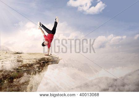 Acrobatic Competition Cartwheel On Mountain