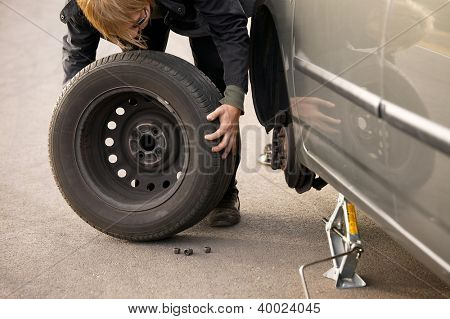 Changing wheel on a car on the roadside