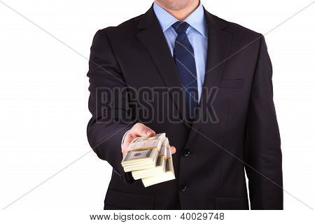 businessman holding large sum of cash