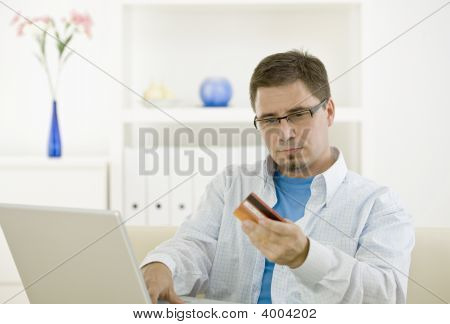 Man Purchasing By Credit Card