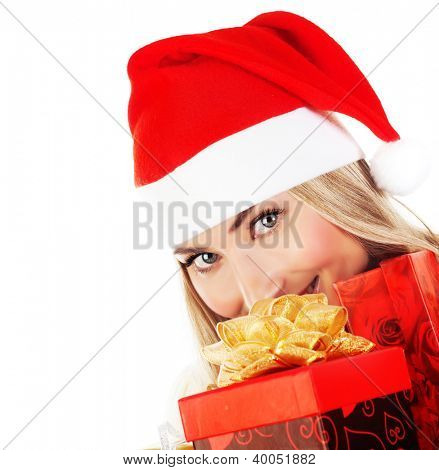 Photo of happy Santa Claus girl with red presents, new gift in hands, excited pretty female isolated on white background, closeup on smiling face, woman celebrating Christmas holiday, wintertime fun