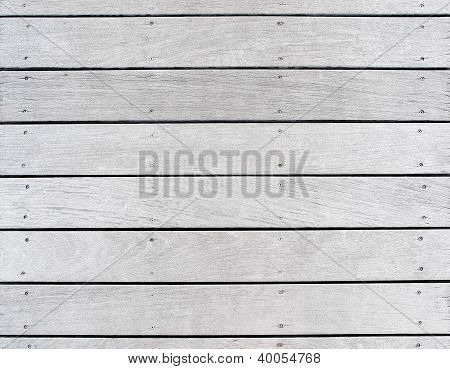 A boat dock's faded wood decking