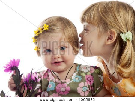 Cute Girl Whispering Something To Her Sister