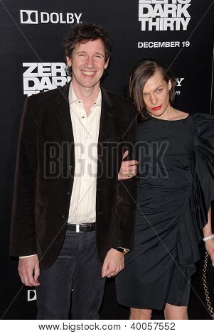 LOS ANGELES - DEC 10:  Paul WS Anderson, Milla Jovovich arrive to the 'Zero Dark Thirty' premiere at Dolby Theater on December 10, 2012 in Los Angeles, CA