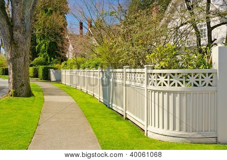 A perfect neighborhood. Houses behind fences in suburb at Spring in the north America