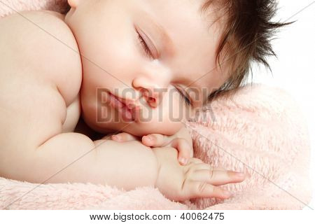 cute baby sleeping, beautiful kid's face closeup, studio shot