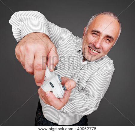 jovial man concentrated on gaming. studio shot over grey background