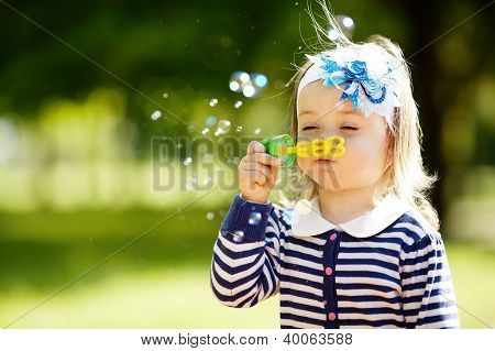 Little Girl Plays With Bubbles