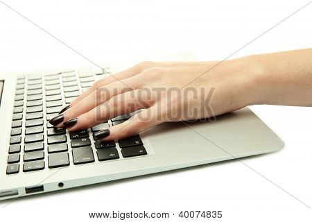 female hands writing on laptot, isolated on white