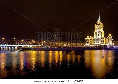 Night View Of Stalin's Vysotka And Novoarbatsky Bridge On In Moscow