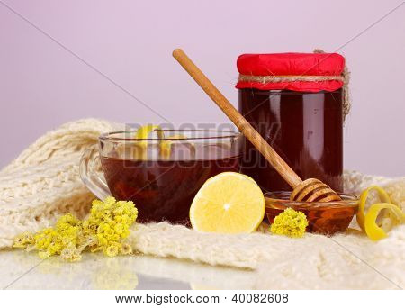 Healthy ingredients for strengthening immunity on warm scarf on purple background