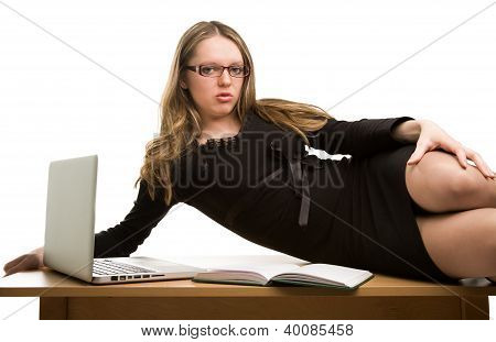Sexy Businesswoman Lying On The Desk