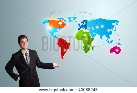handsome young man presenting colorful world map