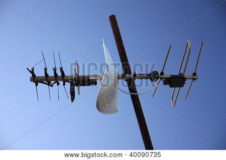 Old Tv Antenna Isolated On Blue Sky