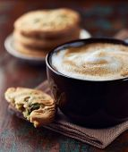 Cup of Latte Coffee and Pistachio Cookies